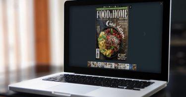 Riviste Online PDF sul laptop con un effetto di capovolgimento di pagina
